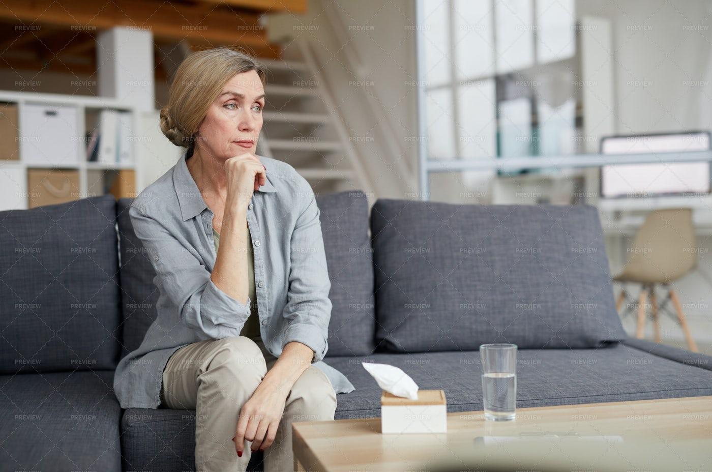 Pensive Mature Woman At Home: Stock Photos