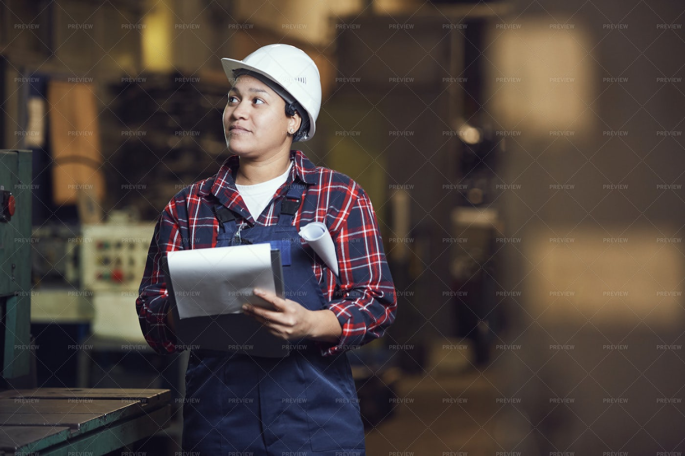 Mixed-Race Female Engineer Working...: Stock Photos