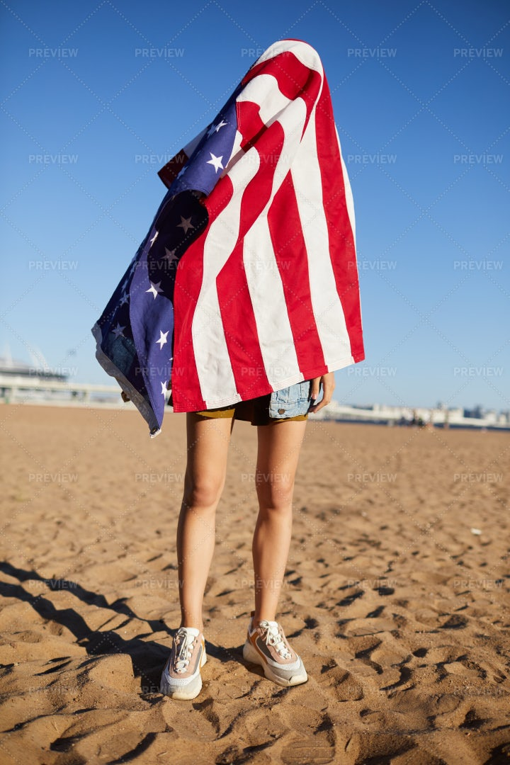 Hiding Under American Flag: Stock Photos