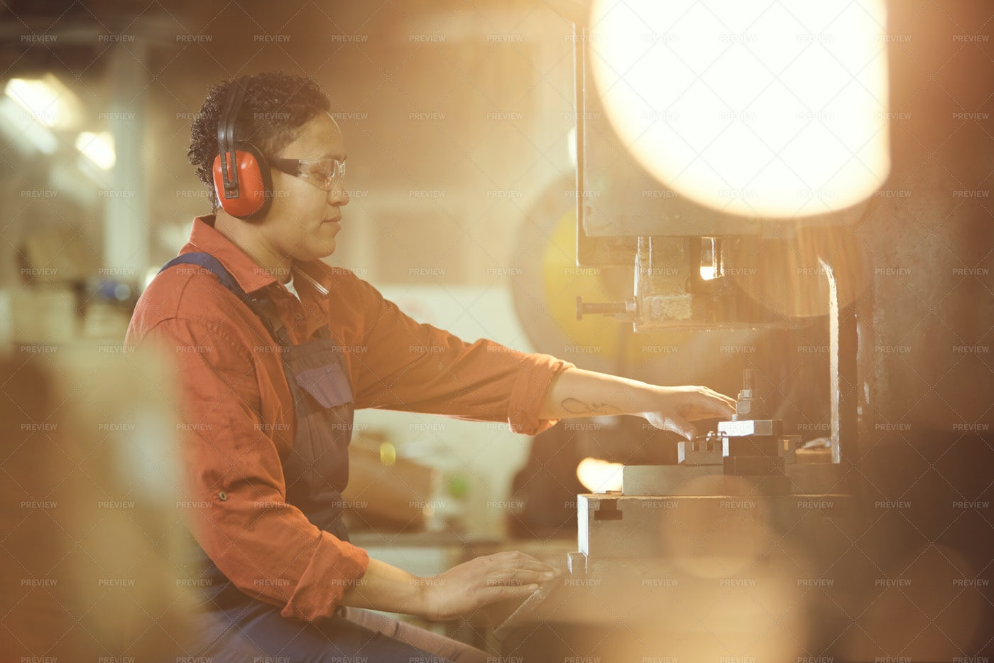 Female Worker Using Heavy Machinery: Stock Photos