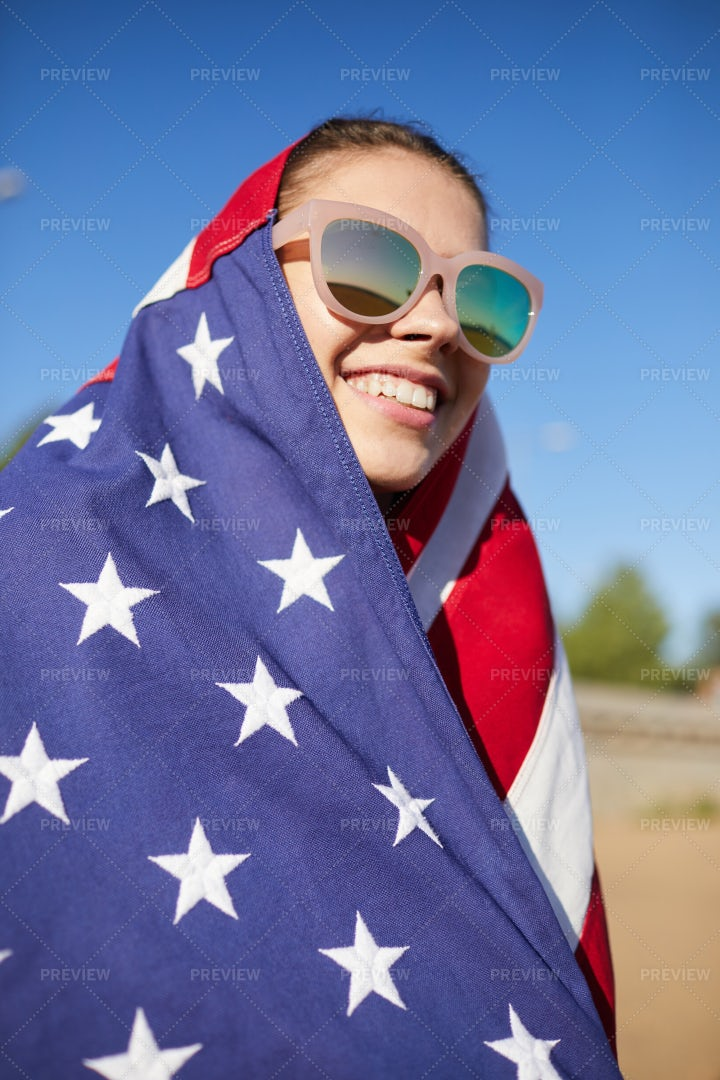 Happy American Girl In Sunglasses: Stock Photos