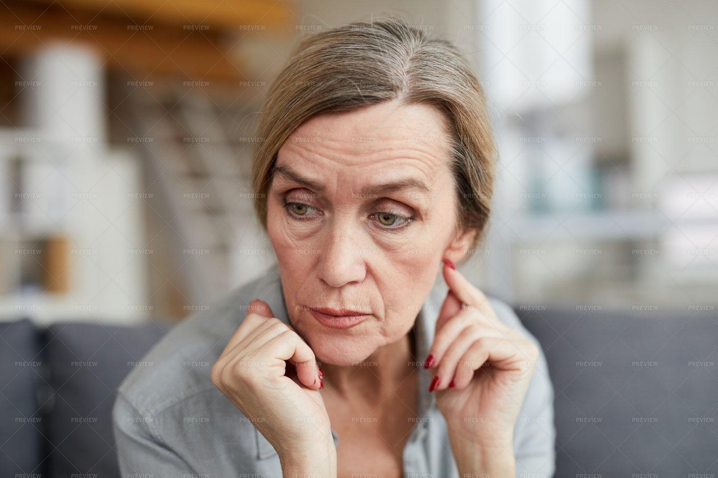 Portrait Of Worried Mature Woman: Stock Photos