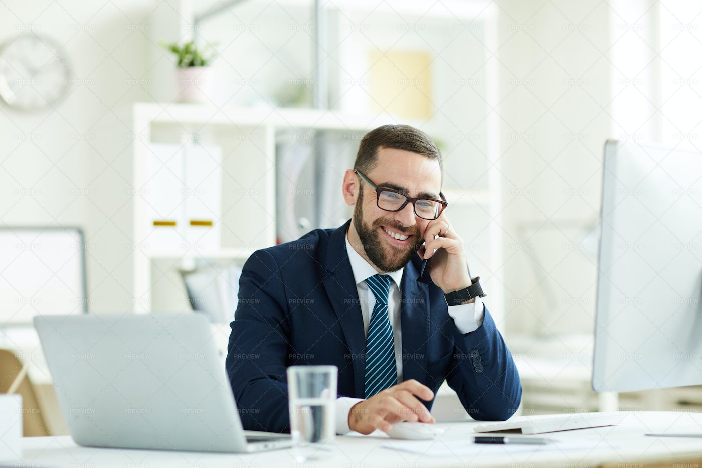 Excited Manager Talking On Phone: Stock Photos