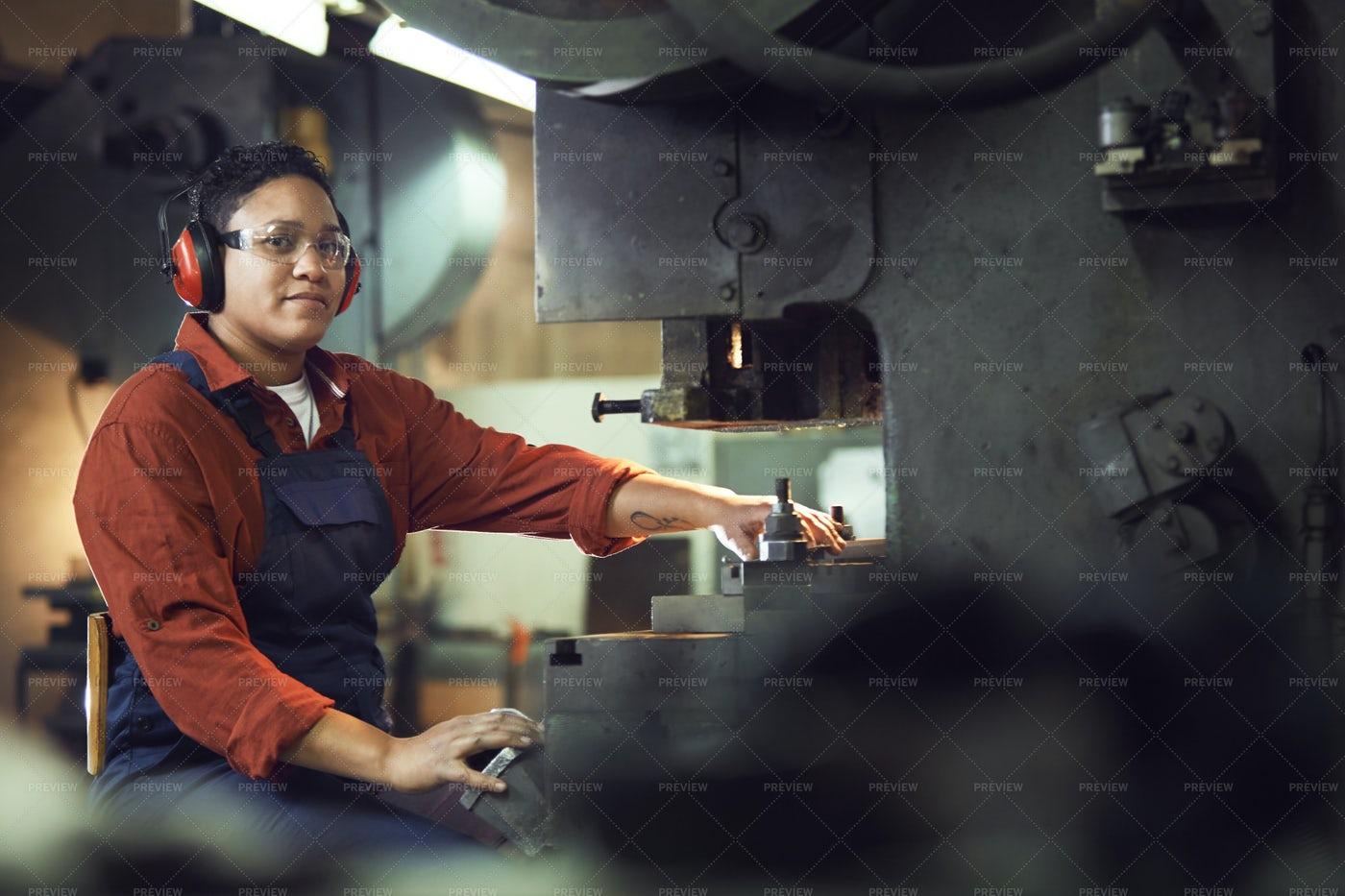 Female Worker Using Heavy Machinery...: Stock Photos