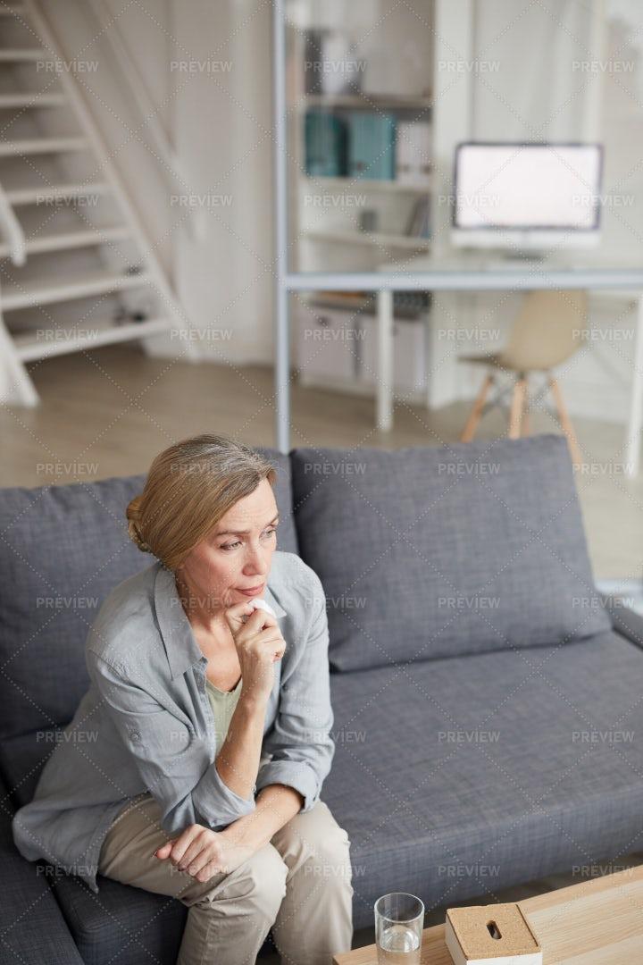 Pensive Mature Woman Crying At Home: Stock Photos