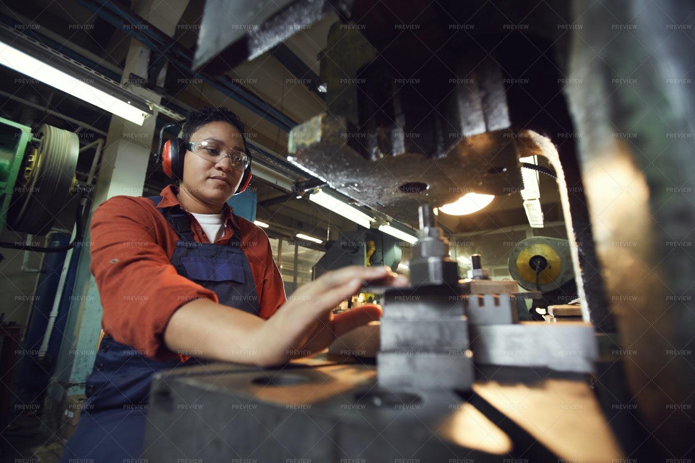 Modern Female Worker Using Heavy...: Stock Photos