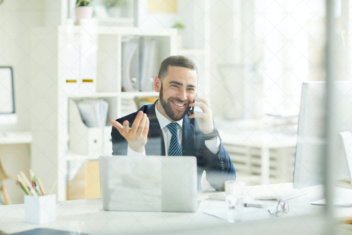 Positive Trader Consoling Customer...: Stock Photos