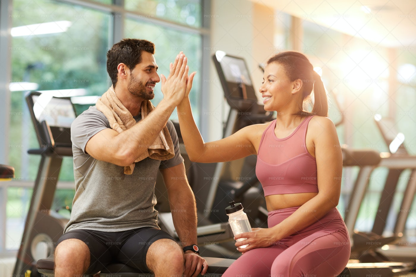 Couple High Fiving In Gym: Stock Photos
