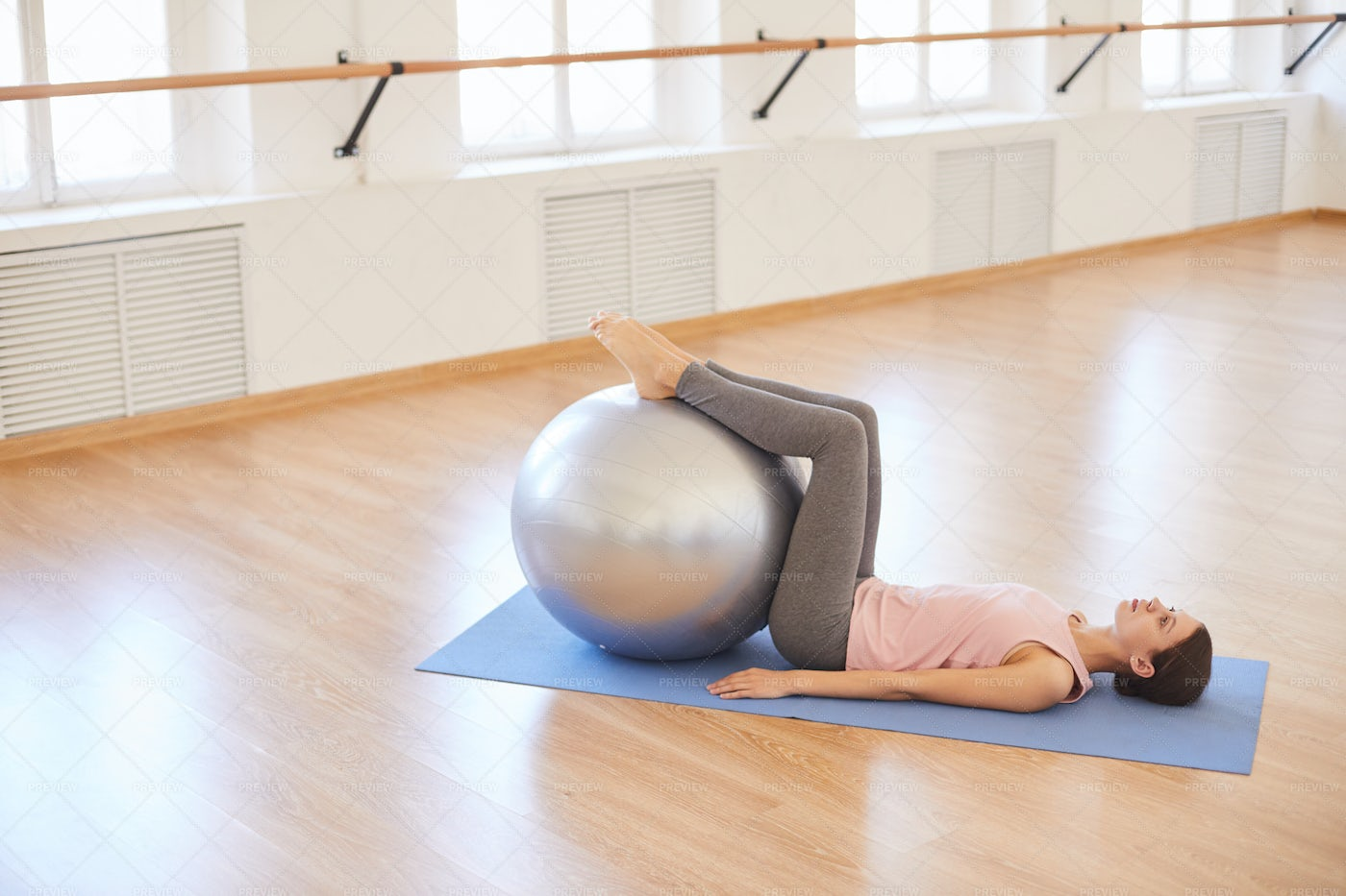 Exercising With Swiss Ball: Stock Photos