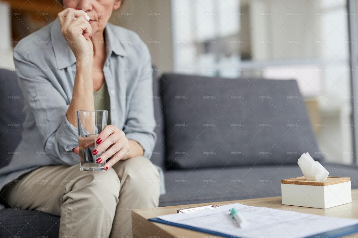 Anxious Mature Woman Drinking Water: Stock Photos