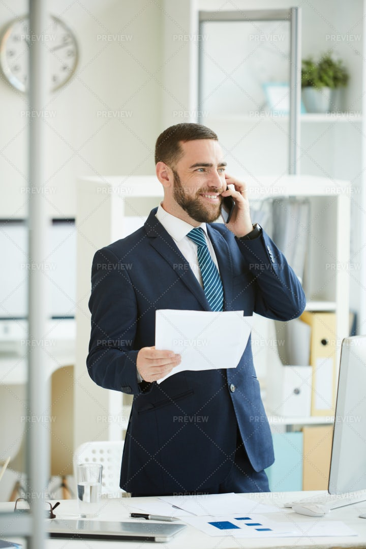 Optimistic Businessman Having Phone...: Stock Photos