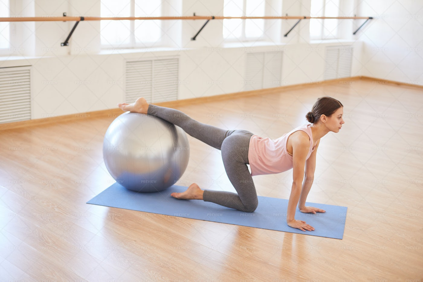 Slim Girl Practicing With Exercise...: Stock Photos