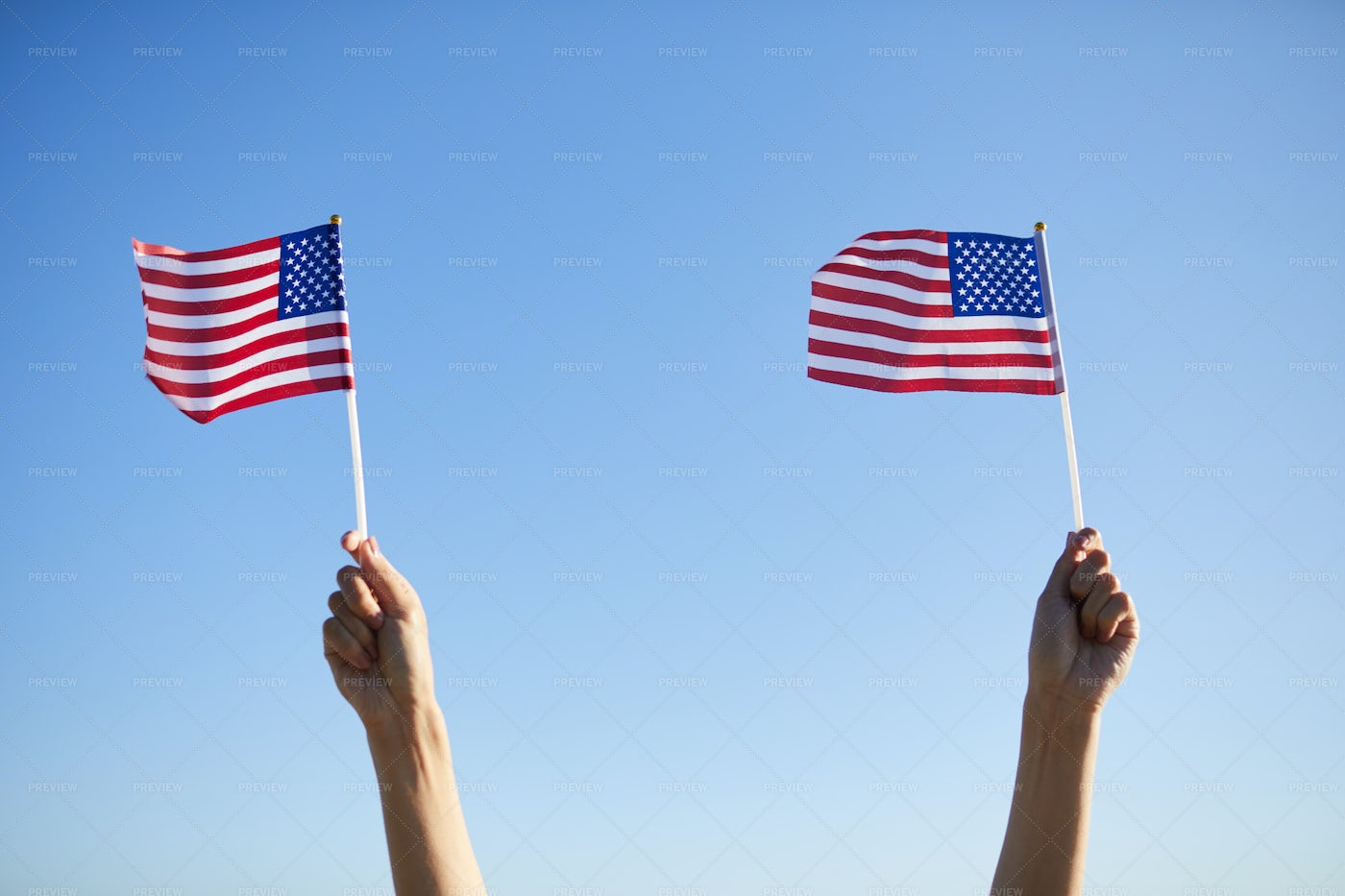 Holding Small Flags At Parade: Stock Photos