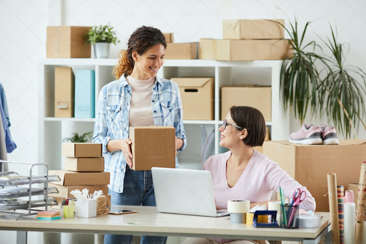 Two Young Managers Of Online Shop...: Stock Photos