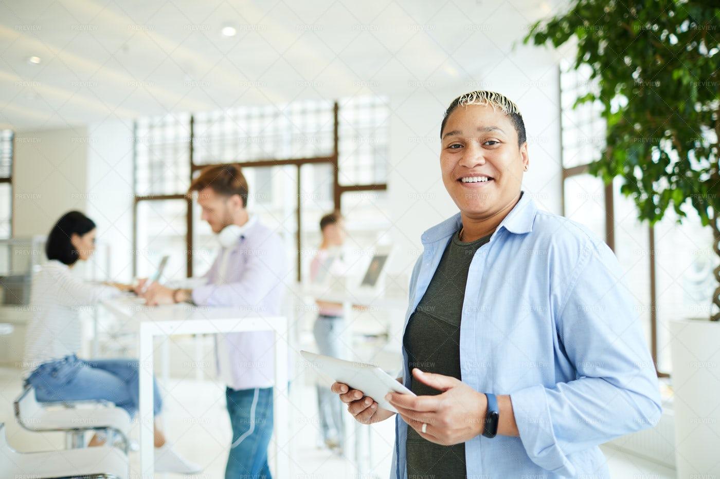 Happy Woman Using Mobile App On...: Stock Photos