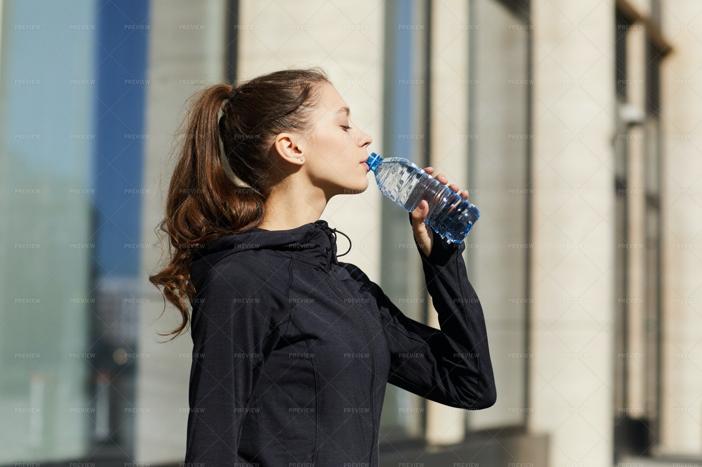 Thirsty Jogger Drinking Water: Stock Photos