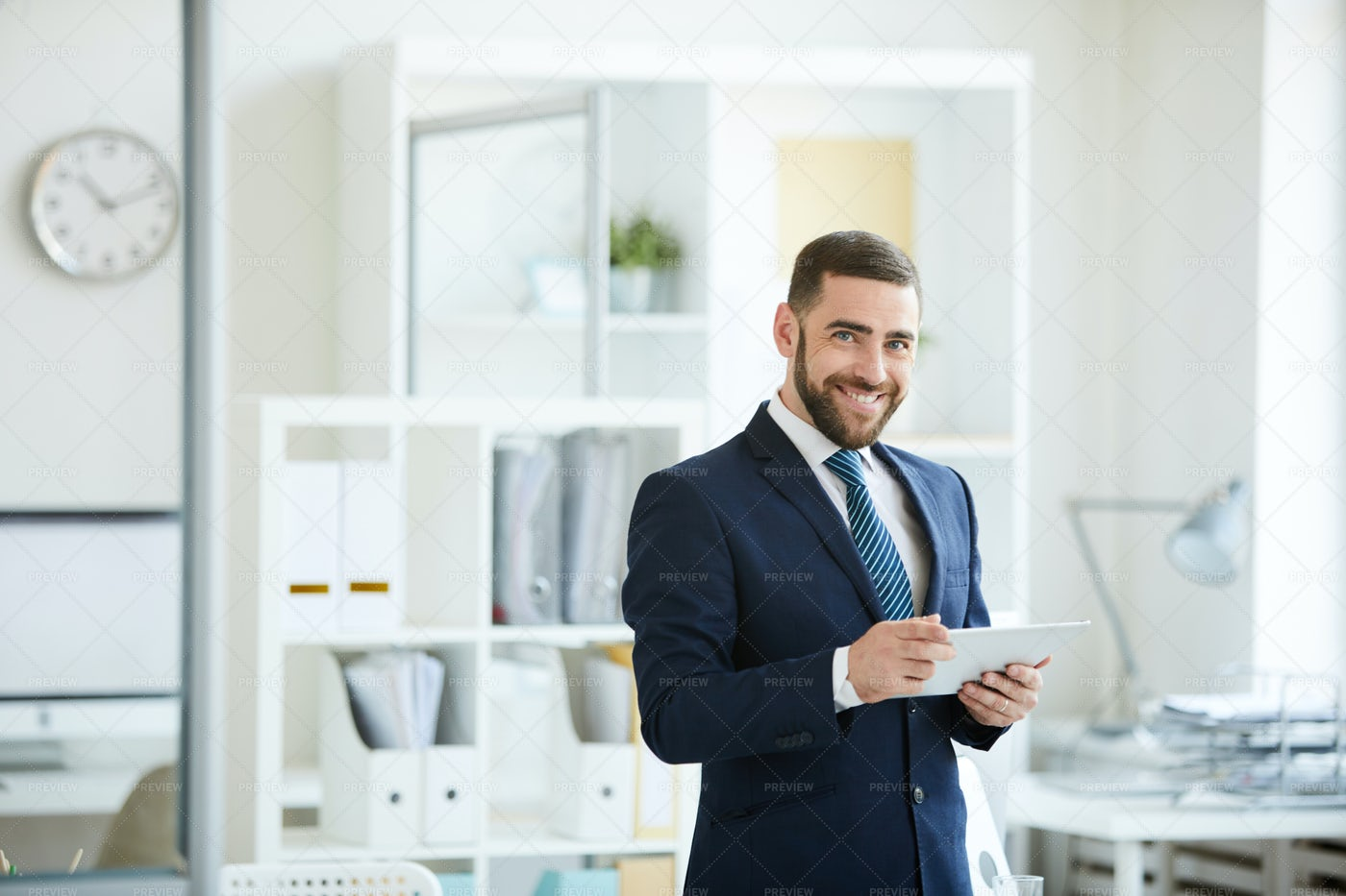 Cheerful Manager Using Tablet: Stock Photos