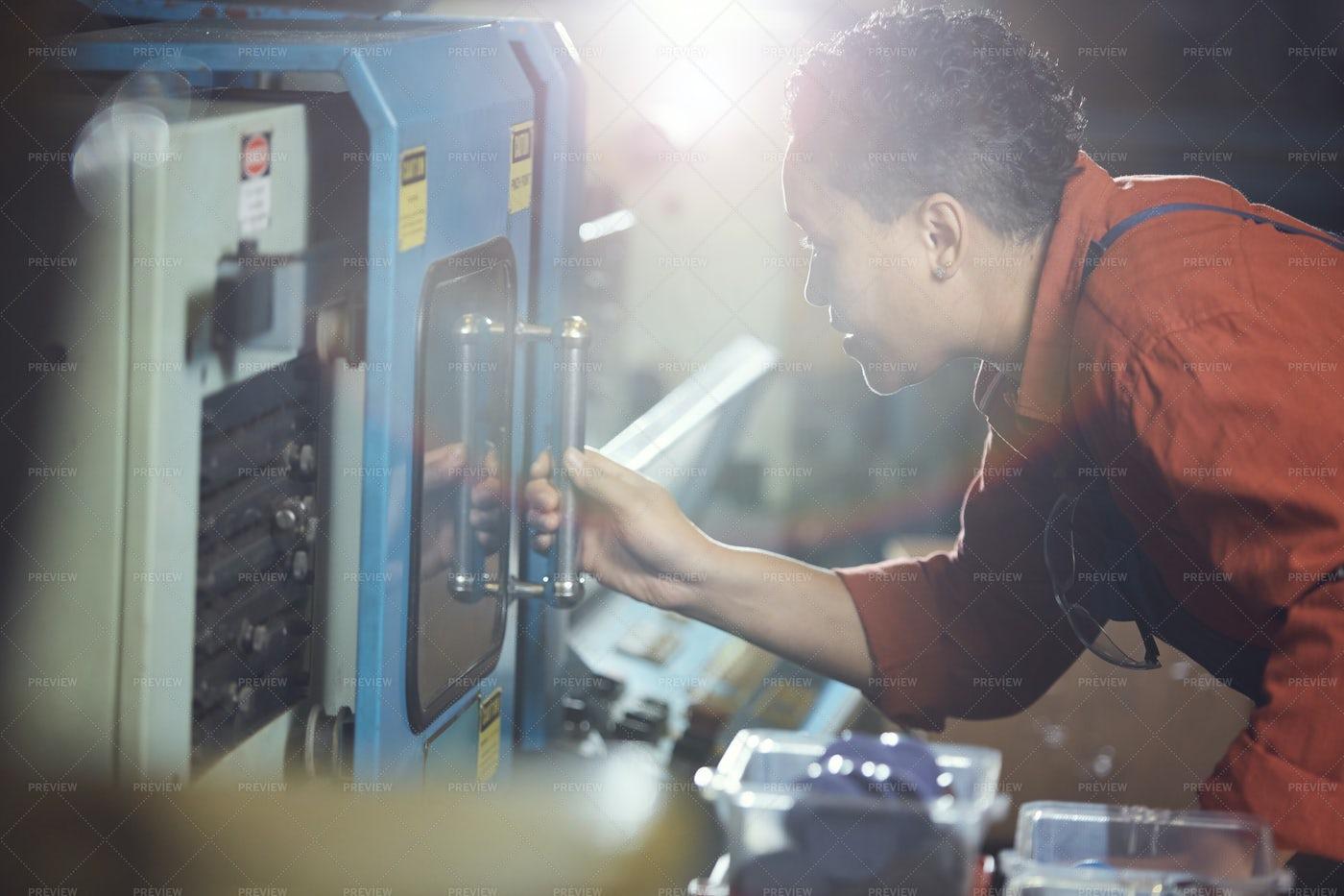 Mixed-Race Woman Working At Factory: Stock Photos