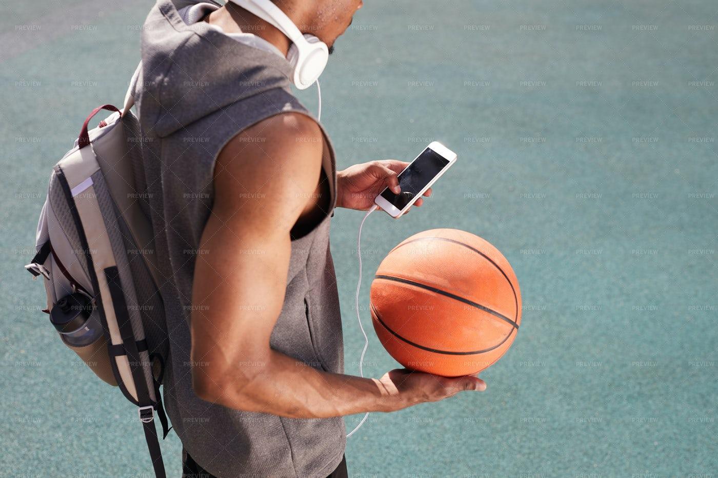 African Sportsman Using Smartphone: Stock Photos