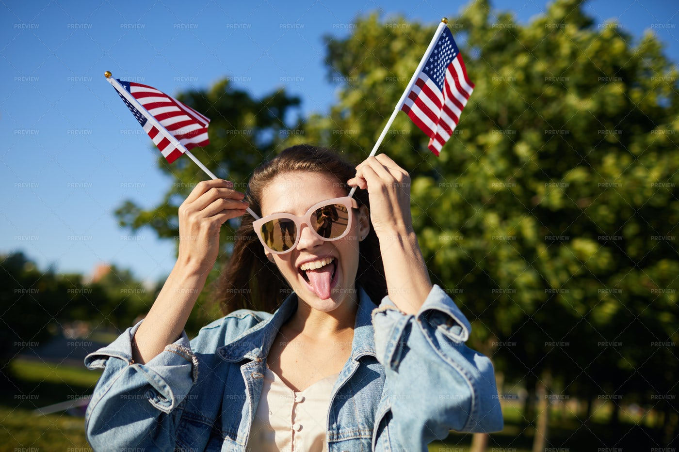 Playful Girl Posing With American...: Stock Photos
