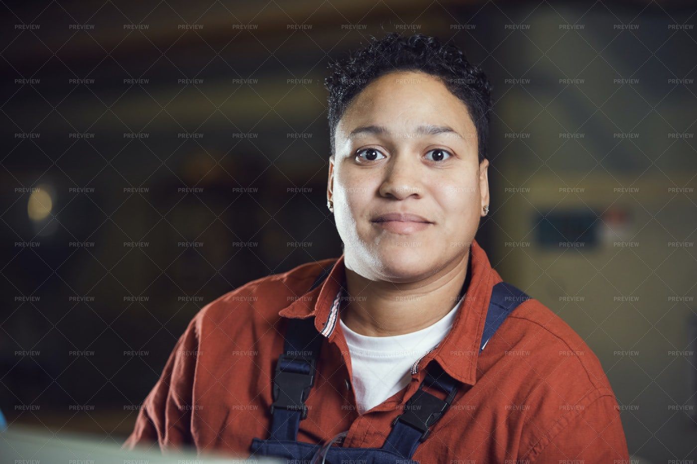 Mixed-Race Female Worker Smiling At...: Stock Photos
