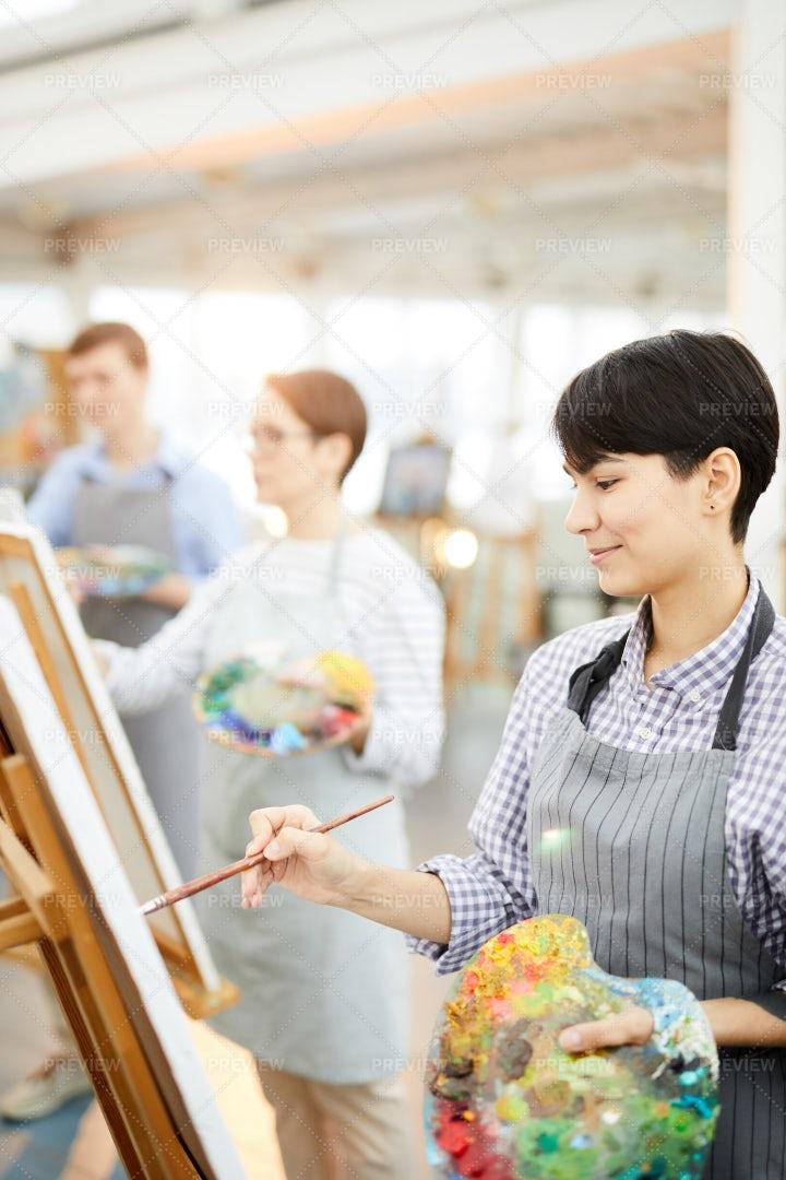 Smiling Artists Working In Studio: Stock Photos