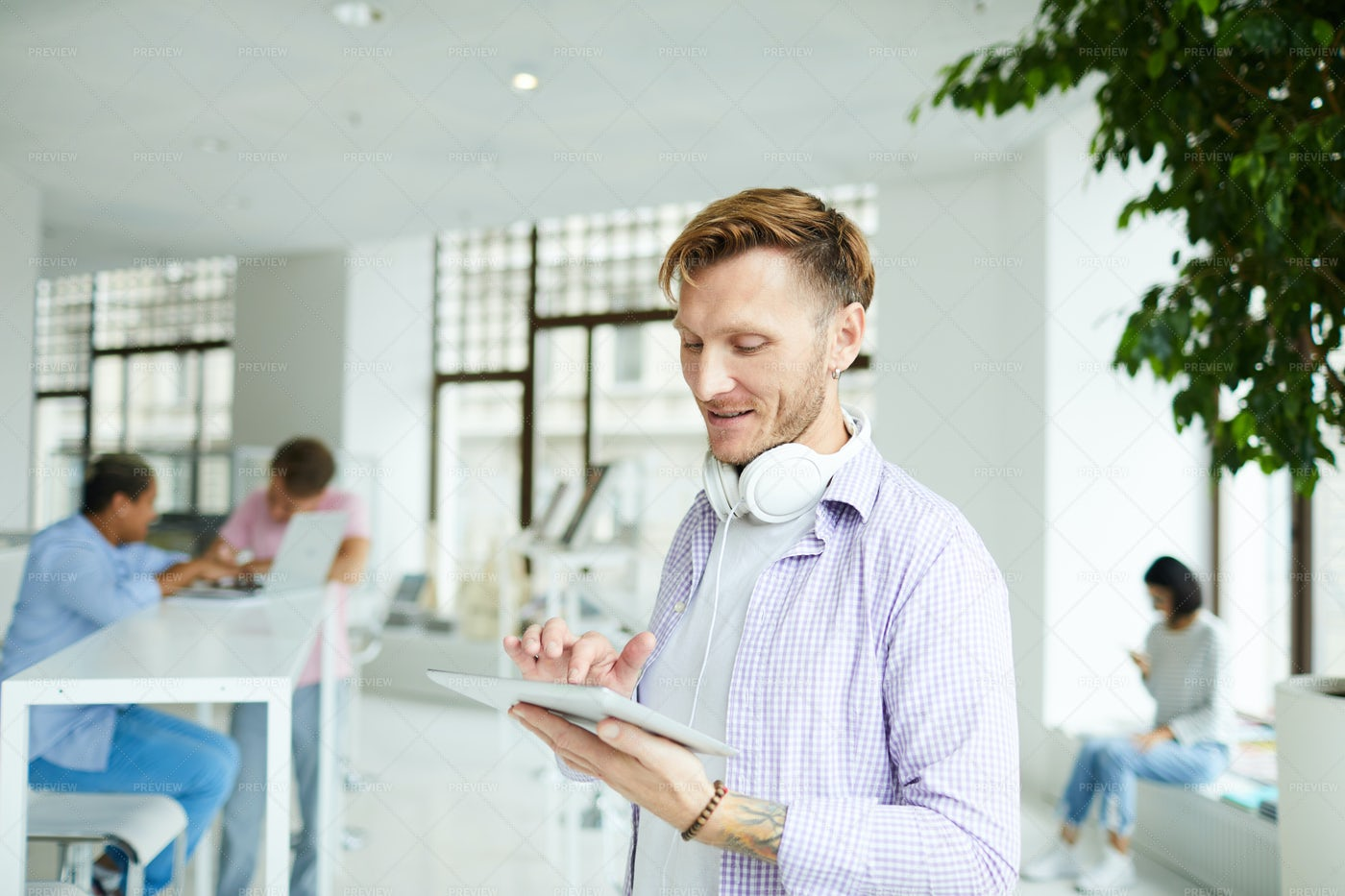 Content Guy Chatting Online In...: Stock Photos