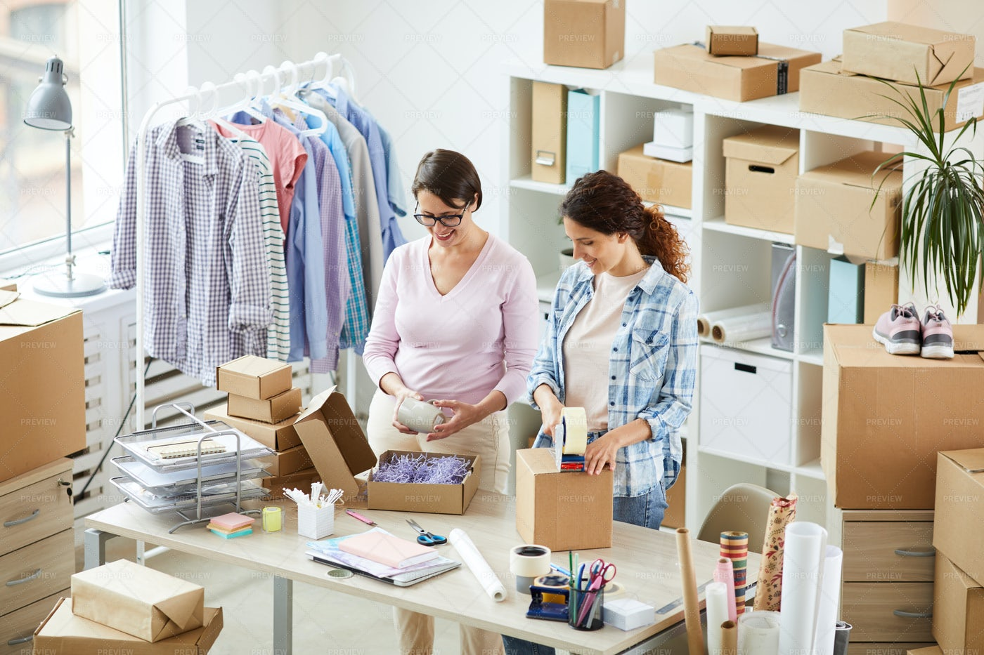 Two Women Packing Products: Stock Photos