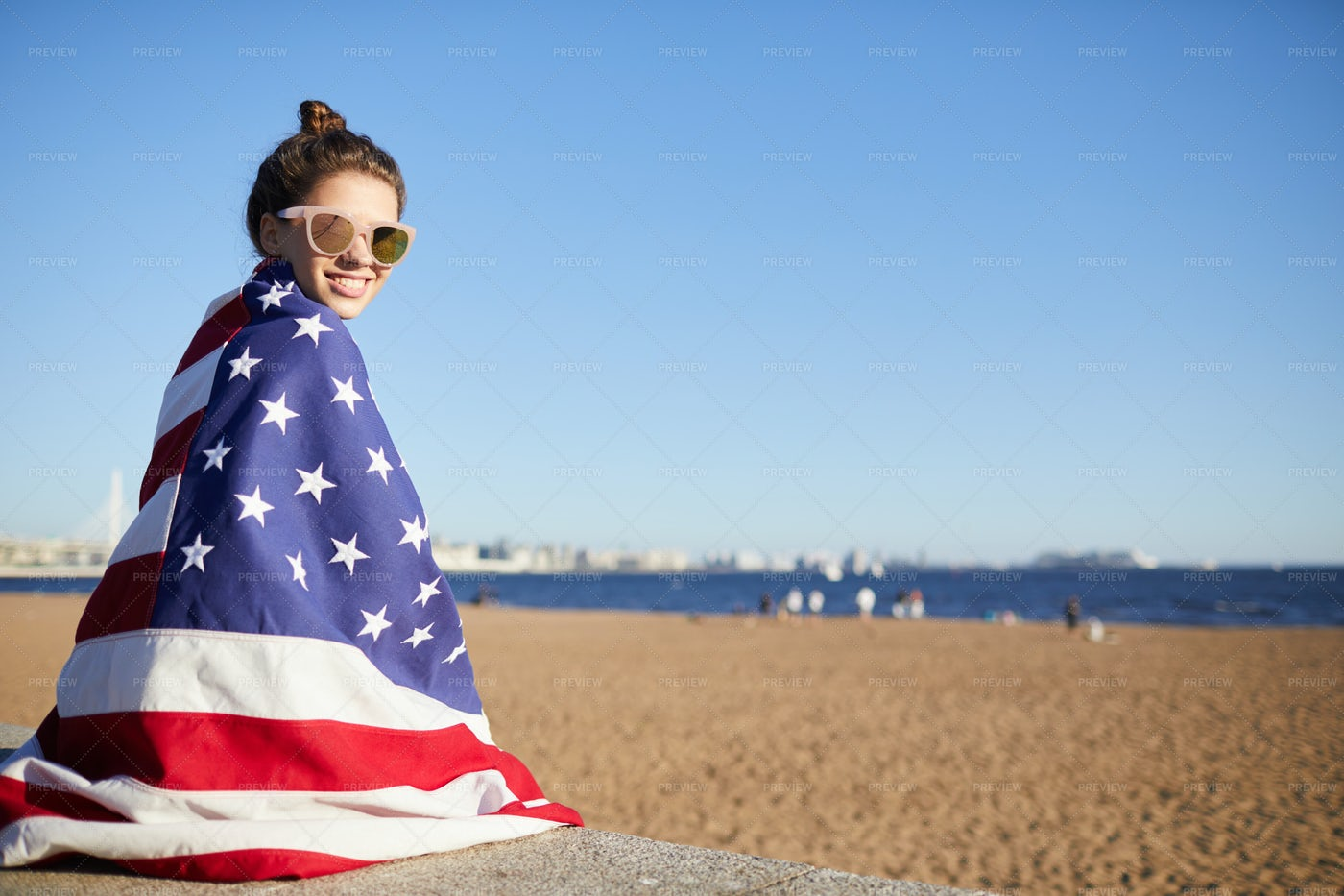 Happy Woman Covered In Big American...: Stock Photos