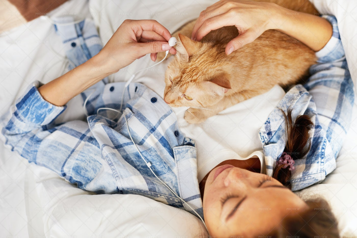 Listening To Music With Cat: Stock Photos