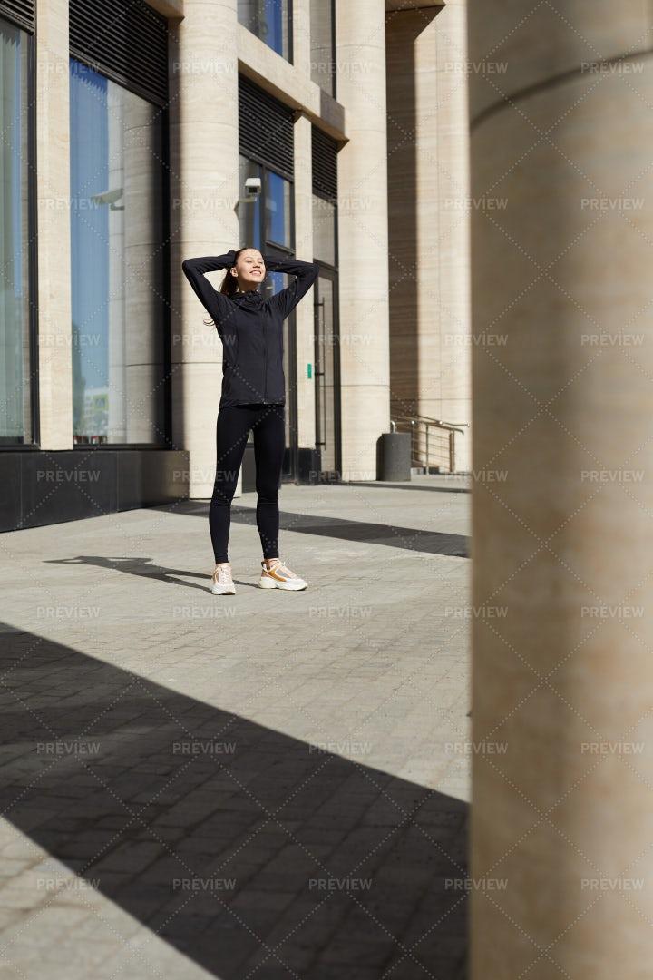 Happy Female Jogger In City: Stock Photos