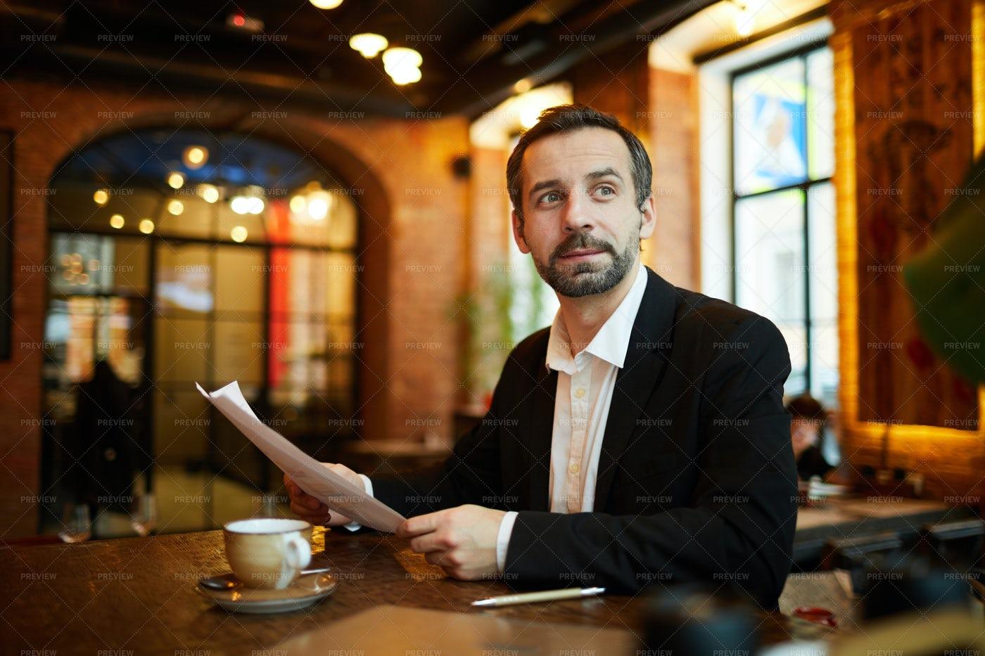Mature Businessman In Cafe: Stock Photos