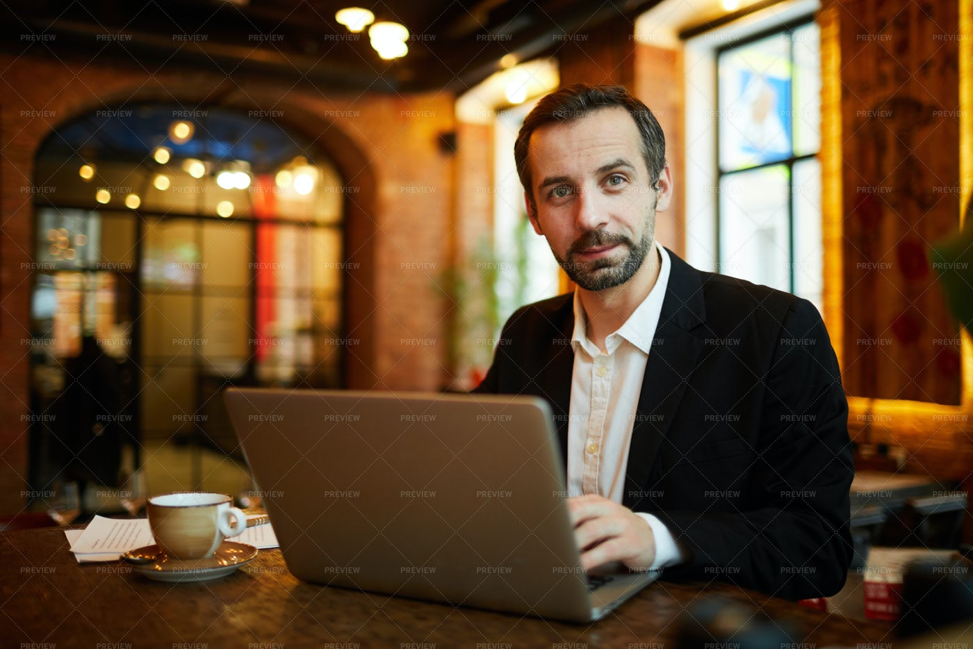 Mature Businessman Working In Cafe: Stock Photos