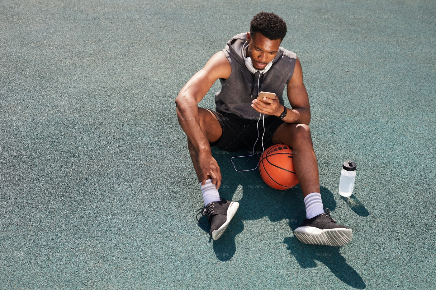 Basketball Player Rests: Stock Photos