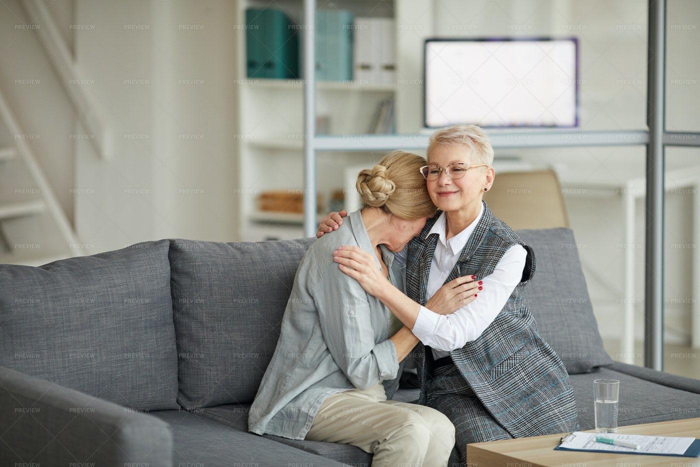 Female Psychologist Comforting...: Stock Photos