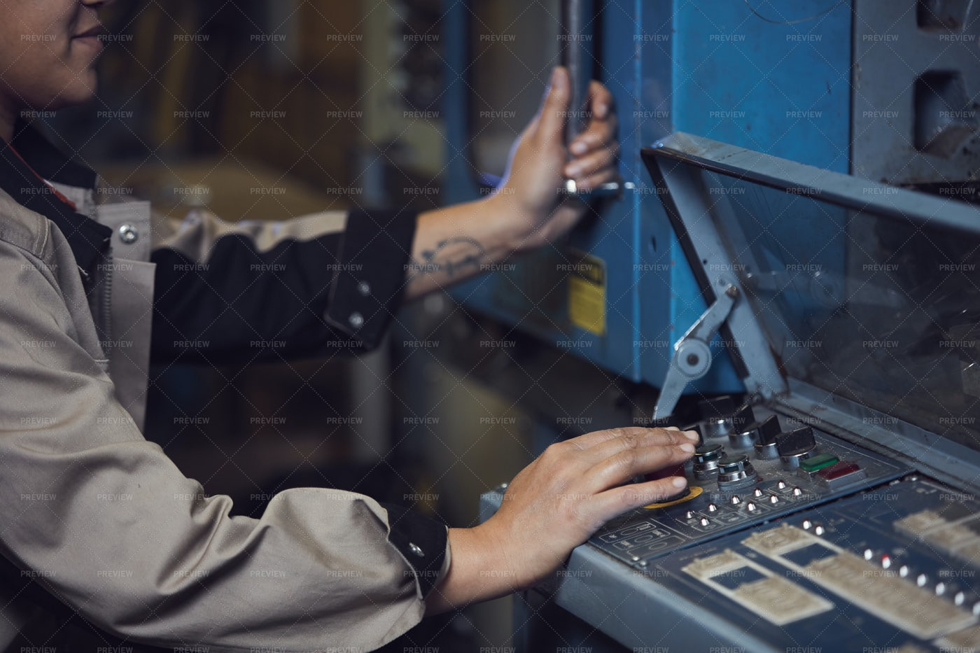 Female Worker Operating Machine...: Stock Photos
