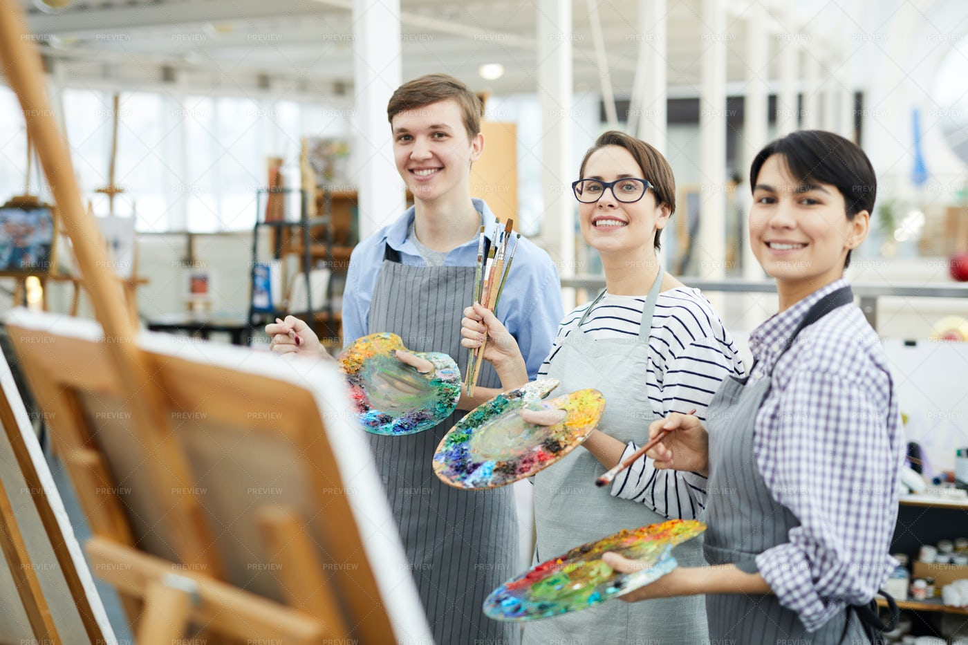 Happy Young Artists Posing: Stock Photos