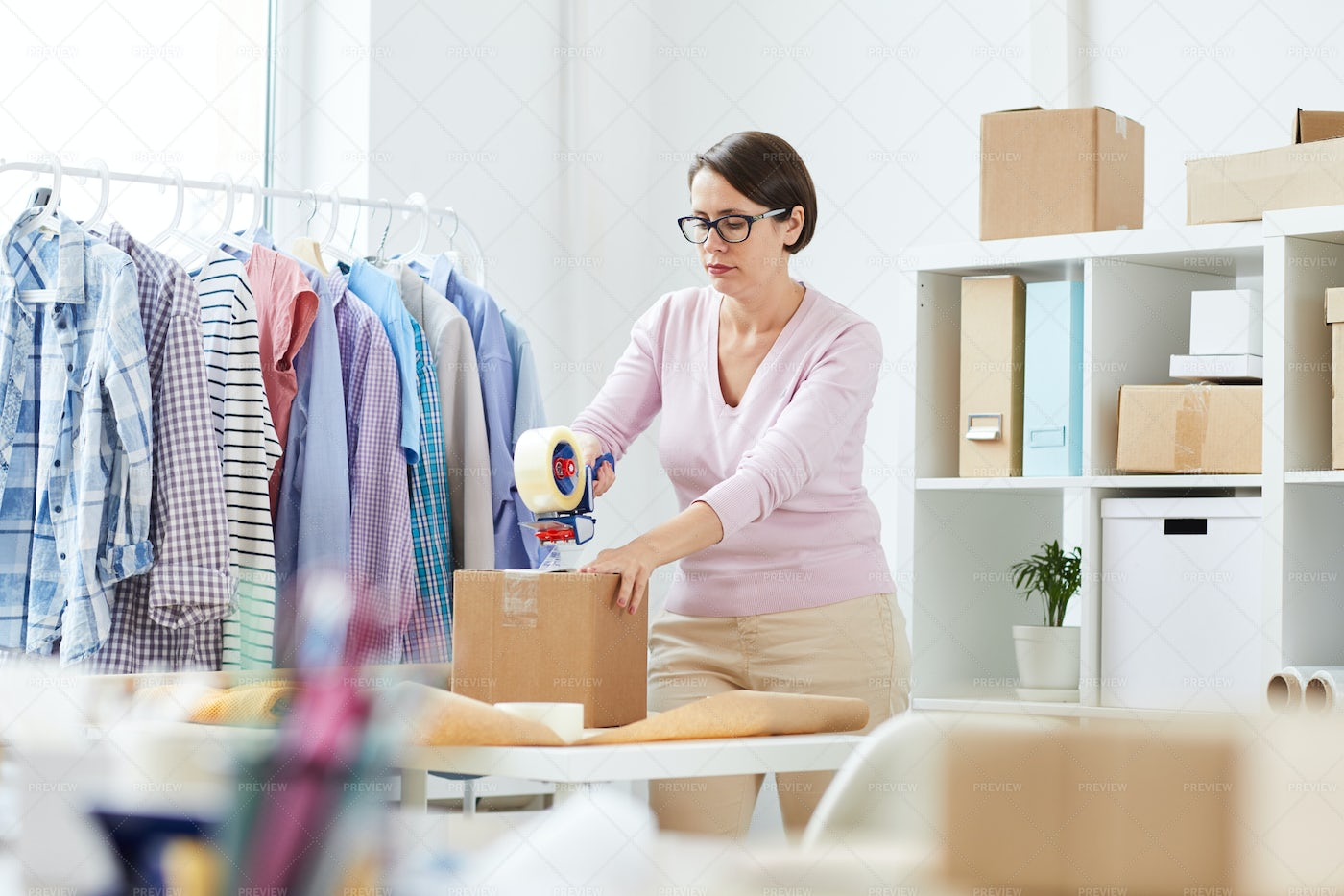 Young Manager Packing Orders Of...: Stock Photos