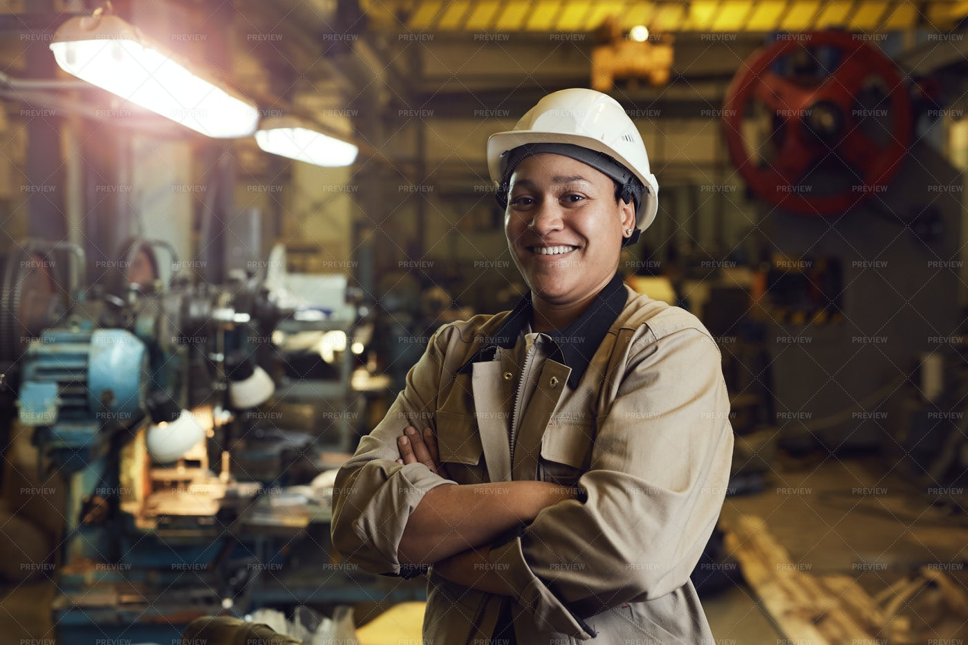 Confident Female Factory Worker: Stock Photos