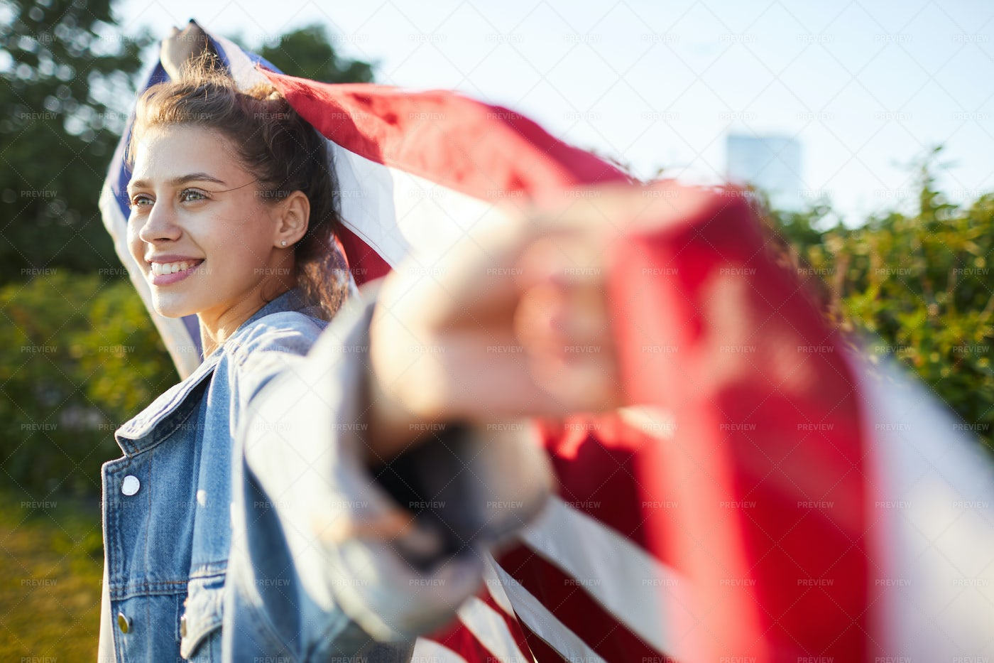 Pensive Female Patriot With US Flag: Stock Photos