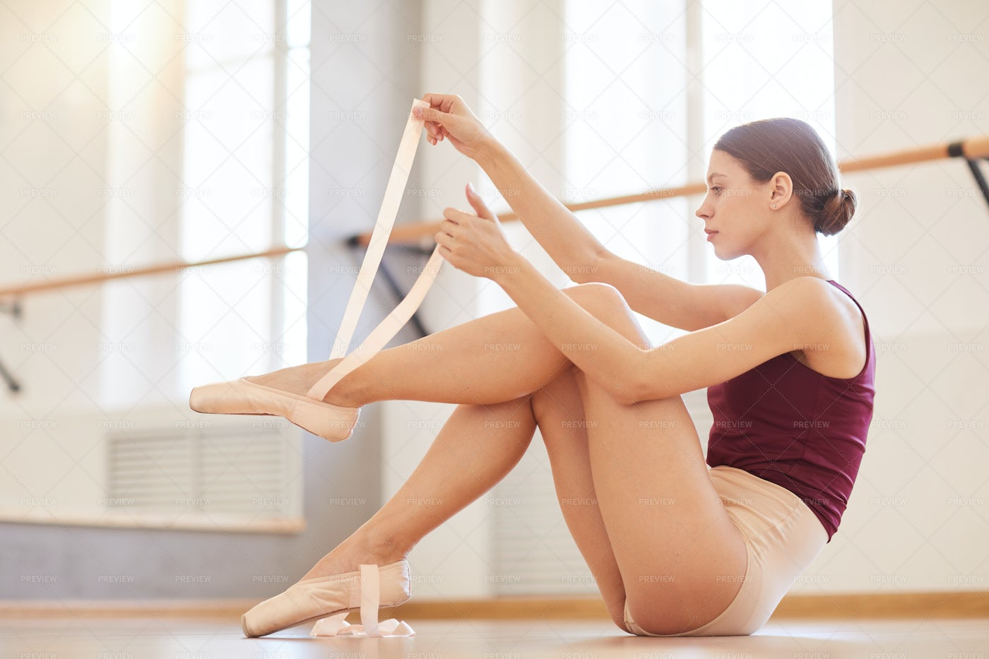 Wrapping Pointe Shoes Ribbon Around...: Stock Photos