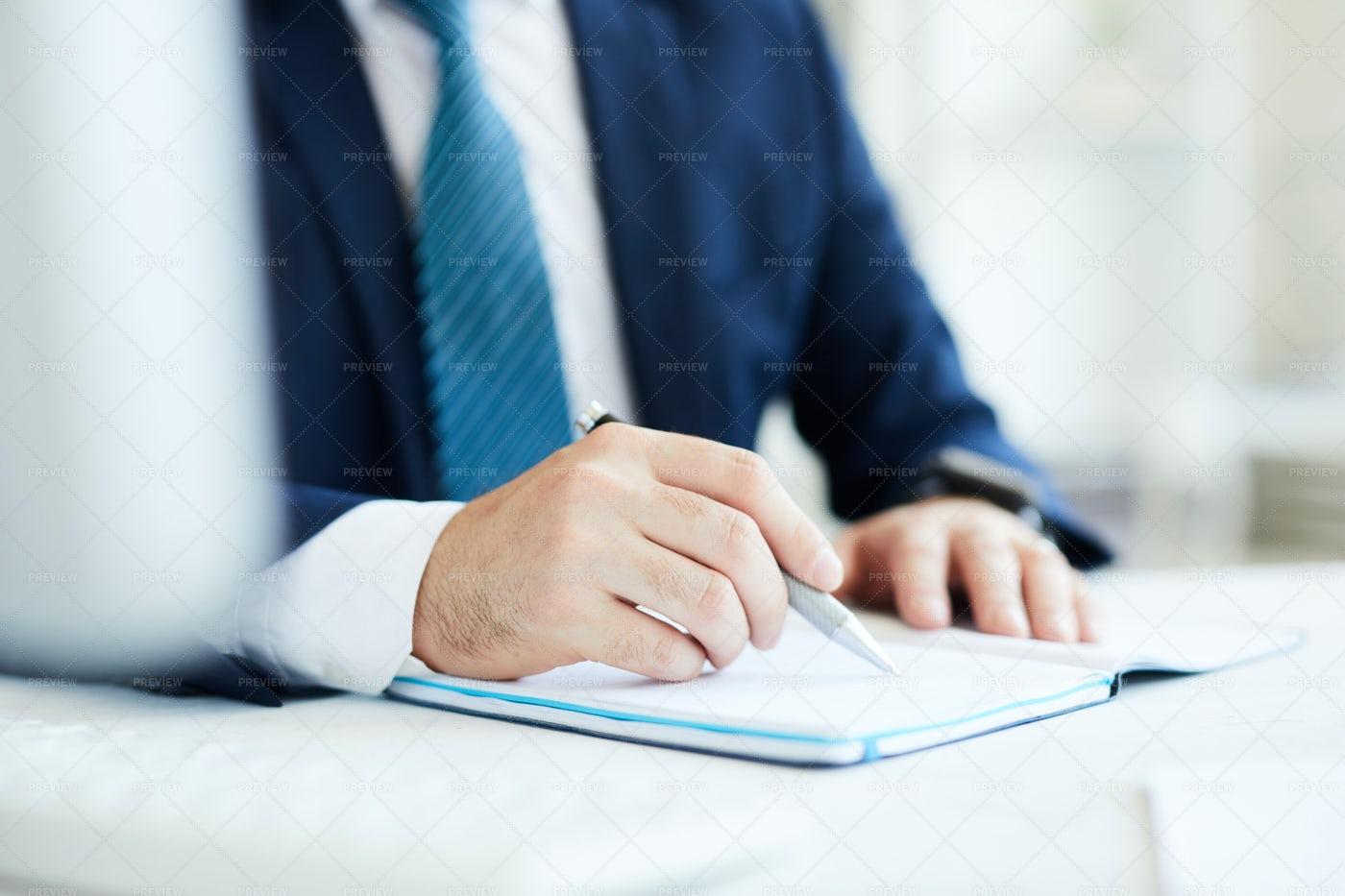 Writing Down Business Goals: Stock Photos