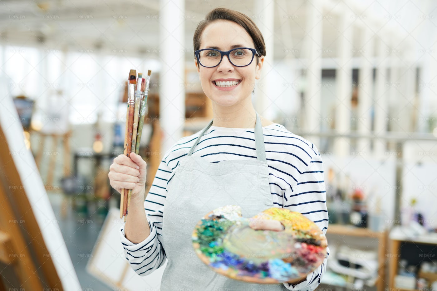 Smiling Female Artist Holding...: Stock Photos