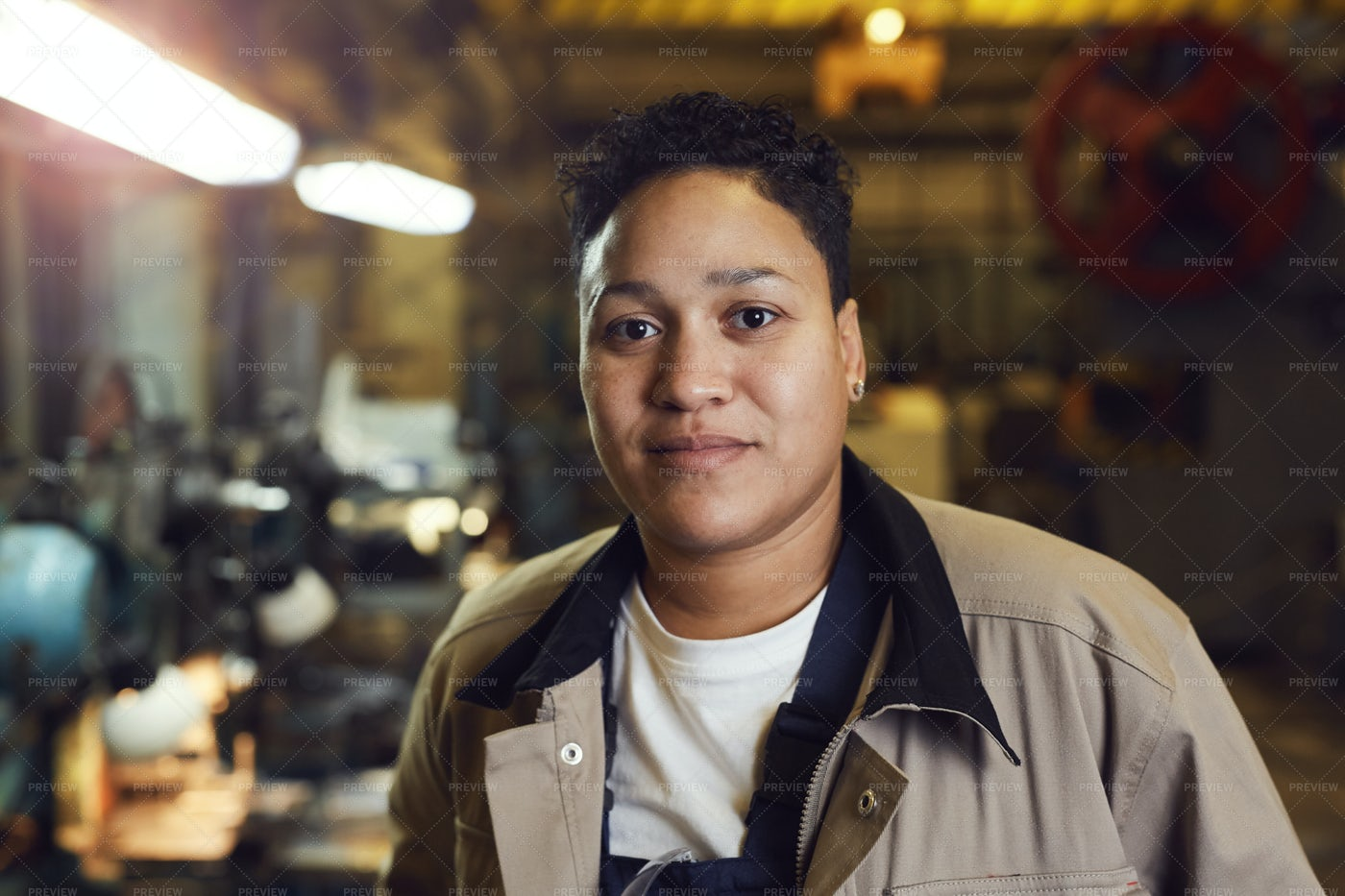 Portrait Of Smiling Female Worker: Stock Photos