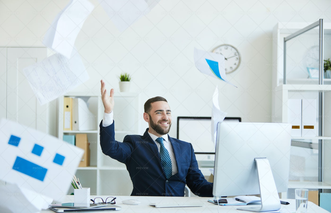Carefree Office Employee Throwing...: Stock Photos