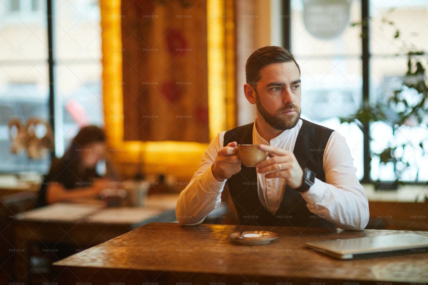 Businessman In Cafe On Coffee Break: Stock Photos