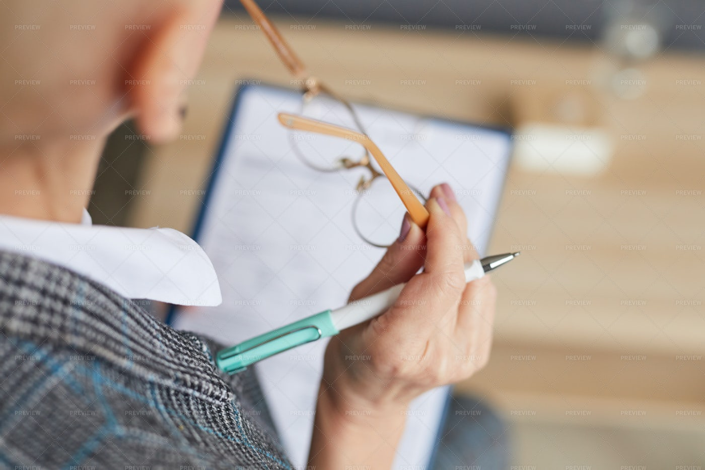 Female Psychologist Writing On...: Stock Photos