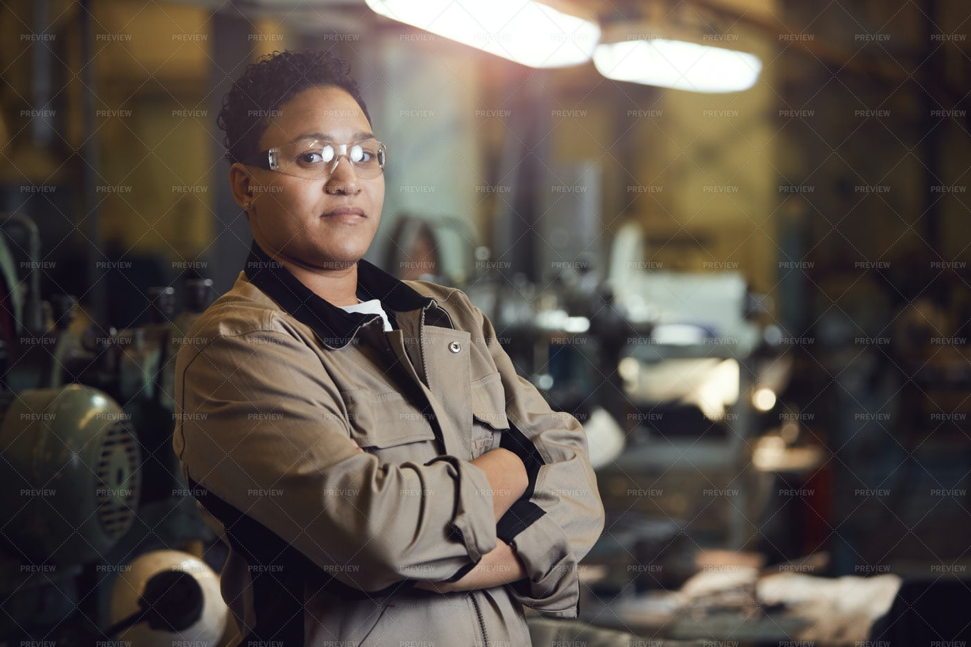 Confident Female Worker Posing At...: Stock Photos
