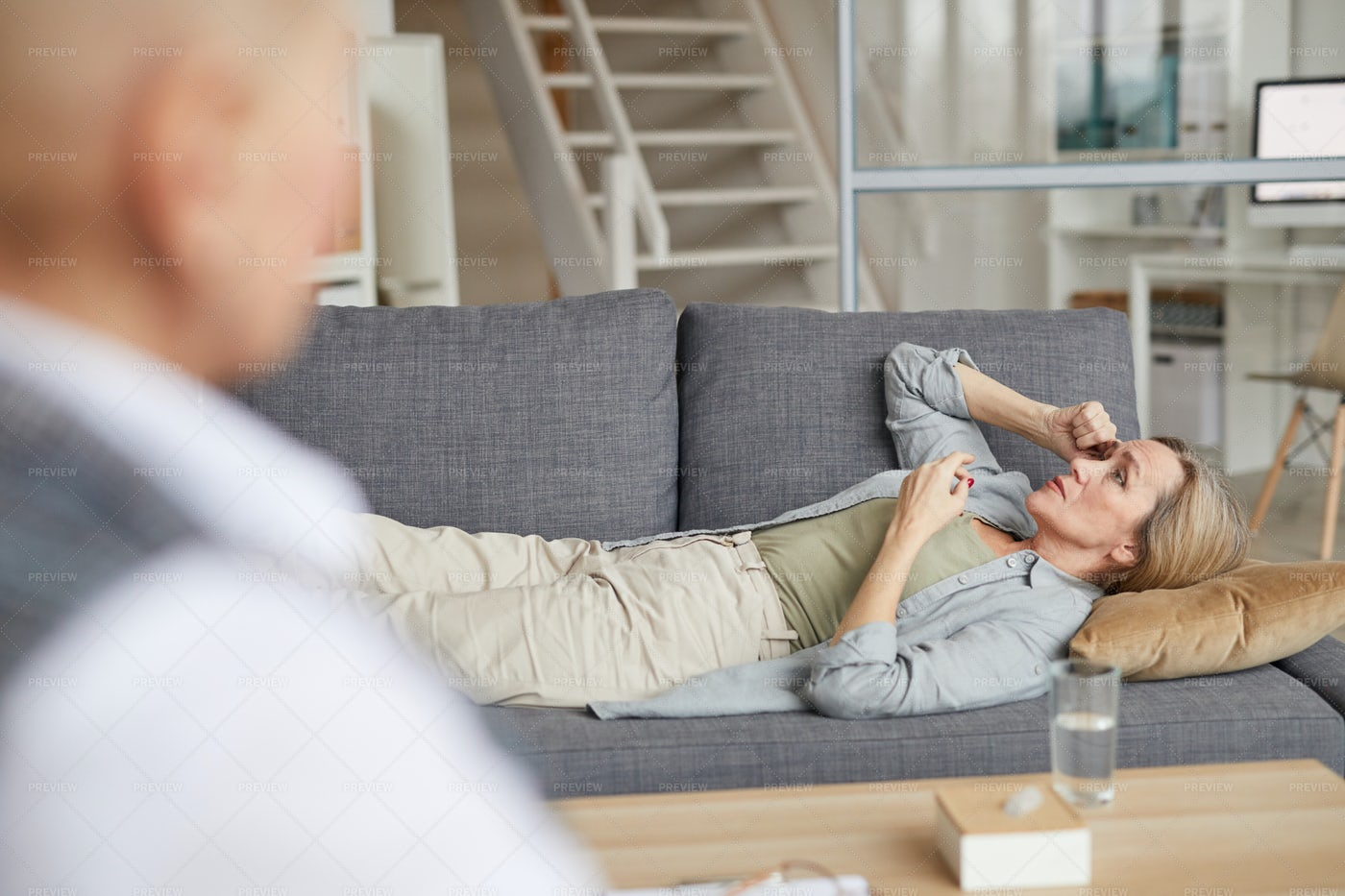Mature Woman Luying On Couch In...: Stock Photos