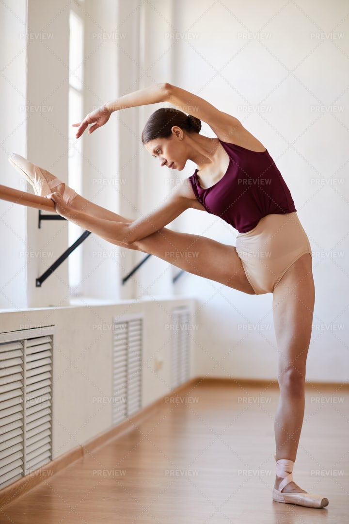 Stretching Leg And Body On Barre: Stock Photos